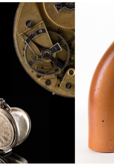 Close up of pocket watches to the left and two clay pipes to the right.