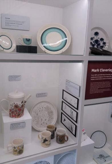 Display of ceramic tableware with various patterns and uses.